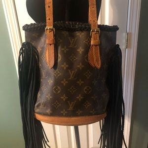 Authentic Louis Vuitton bucket bag with fringe
